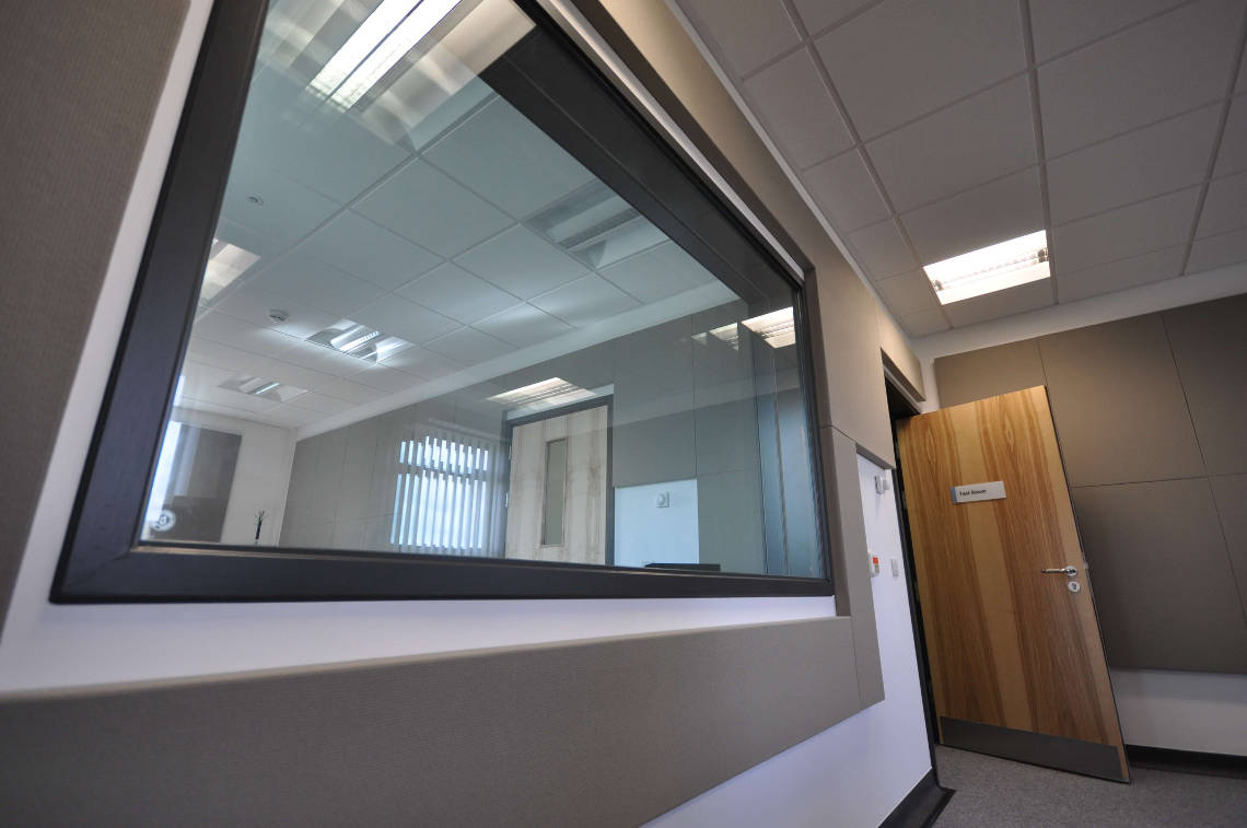 large soundproof window in double wall audiometric sound room