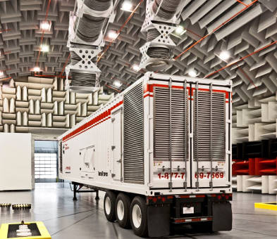 red and white truck in semi-anechoic chamber with metal wedges
