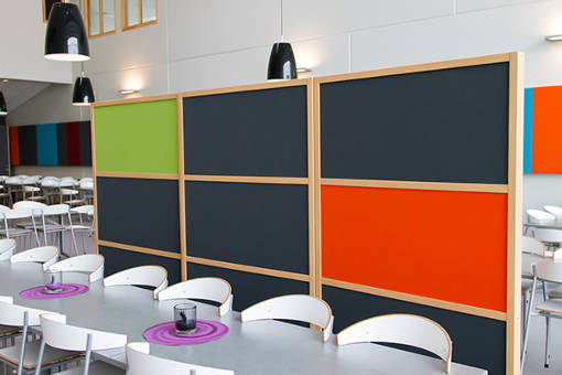 noise screen in several colours placed in canteen